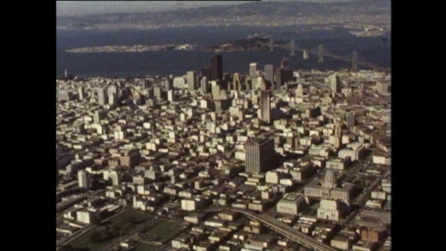 aerial of san francisco city and oakland bay bridge; 1970 - san francisco oakland bay bridge stock videos & royalty-free footage