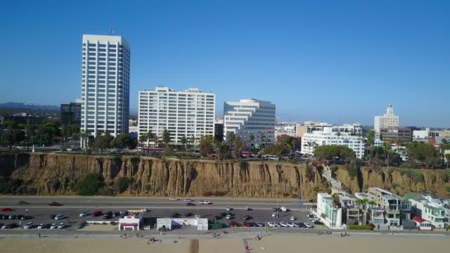 aerial of santa monica beach and modern buildings - santa monica stock videos and b-roll footage
