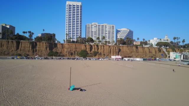 aerial of santa monica beach on a high sunny day - santa monica stock videos and b-roll footage