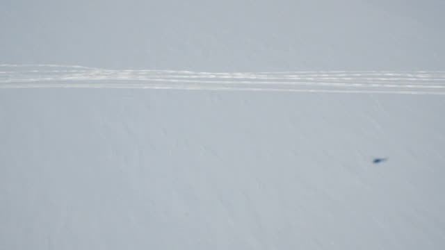 Aerial of shadow of helicopter on the snow, Antarctica