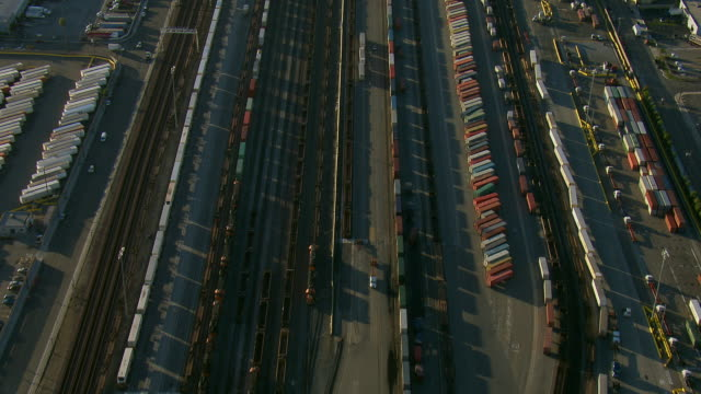 aerial of shipping containers in rail yard - shunting yard stock videos and b-roll footage