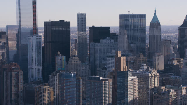 aerial of skyscrapers and high rise office or apartment buildings in downtown manhattan new york city skyline.