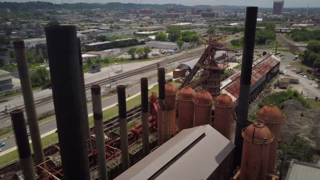aerial of sloss furnaces site in birmingham - birmingham alabama video stock e b–roll