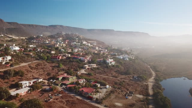 Aerial of Small Town and Blue River in Baja Mexico