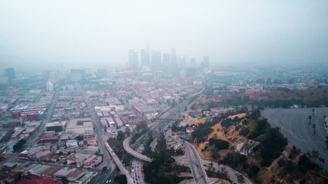 aerial of smog filled la with traffic - smog video stock e b–roll