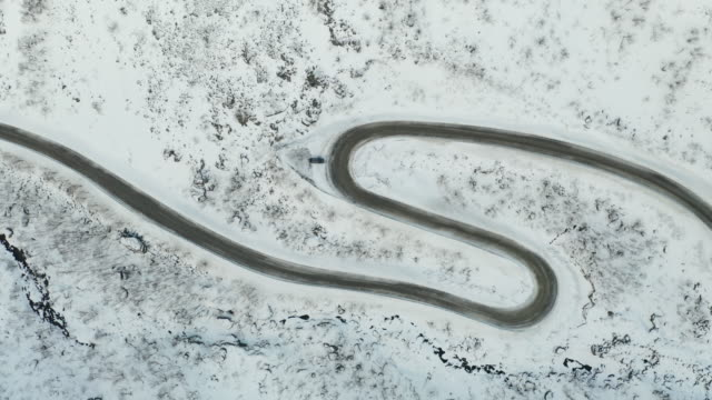 aerial of snow covered mountain road near to medby on the island of senja, norway. - road stock videos & royalty-free footage