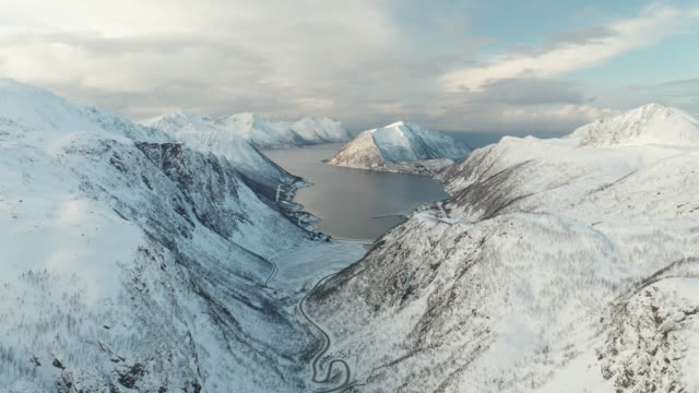 aerial of snow covered mountains near to medby on the island of senja, norway. - dramatic landscape stock videos & royalty-free footage