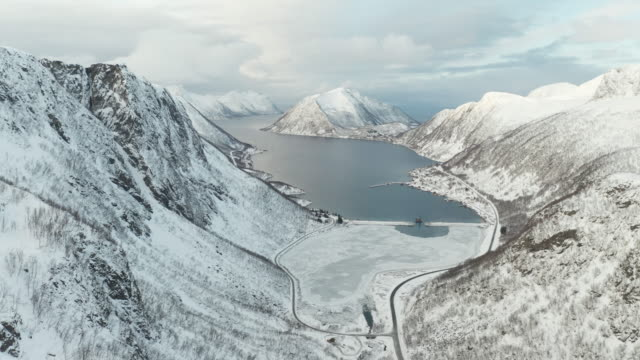 aerial of snow covered mountains near to medby on the island of senja, norway. - norway stock videos & royalty-free footage