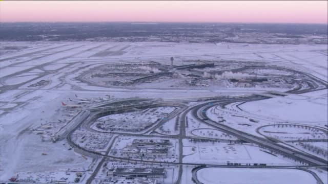 wgn aerial of snowcovered o'hare airport in chicago on january 20 2014 - o'hare airport stock videos & royalty-free footage