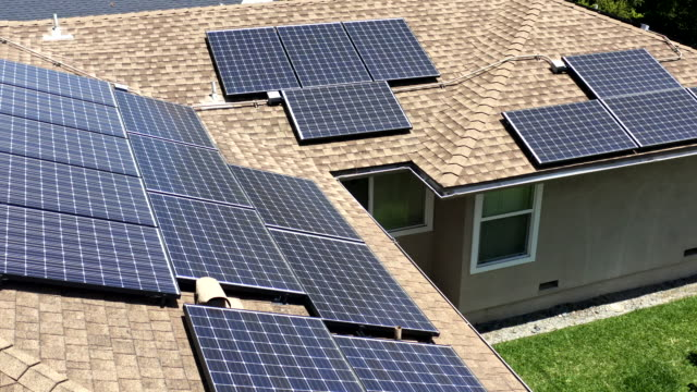 aerial of solar panels on residential home - energy efficient stock videos & royalty-free footage