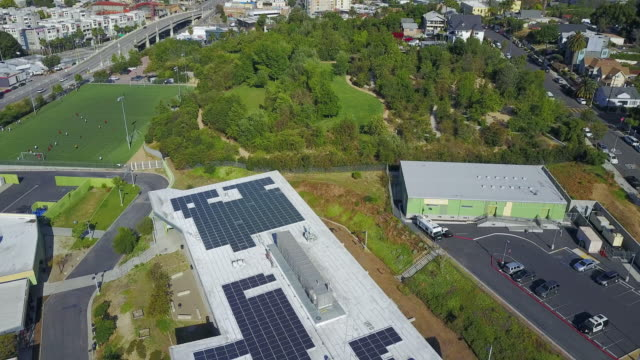 Aerial of Solar Panels on the Building Roof Tops