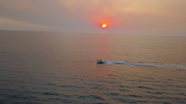 aerial of speed boat on manhattan beach - motorboat stock videos and b-roll footage