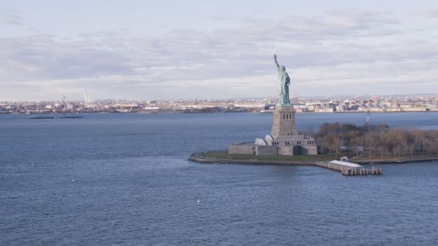 aerial of statue of liberty in new york harbor. landmarks. - weibliche figur stock-videos und b-roll-filmmaterial