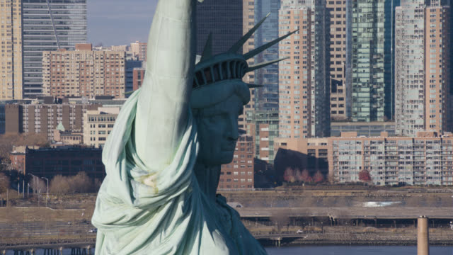 aerial of statue of libery. landmark. - female likeness stock videos & royalty-free footage