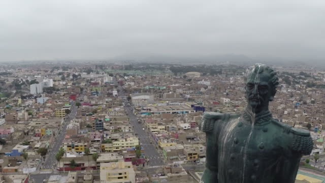 aerial of statue overlooking town - lima stock videos & royalty-free footage