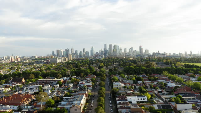 aerial of suburban melbourne and cbd at sunset - skyline stock videos & royalty-free footage