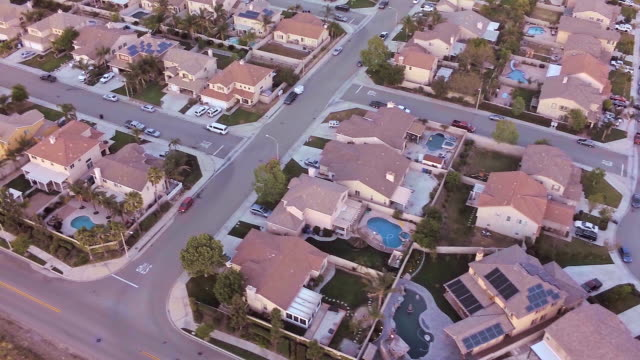 aerial of suburban neighborhood - tract housing stock videos & royalty-free footage