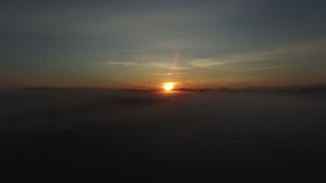 4k aerial of sunrise over mysterious clouds - horizont über land stock-videos und b-roll-filmmaterial