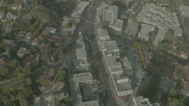 Aerial of sunset boulevard. along sunset strip between Beverly Hills and West Hollywood, California. high rises, apartment and office buildings, billboards, trees, cars, traffic. city streets.