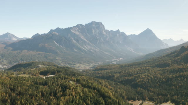 aerial of the autumn colour and the craggy mountains of the dolomites in northern italy. - wilderness stock videos & royalty-free footage