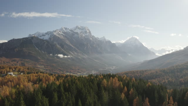 aerial of the autumn colour around the pomagagnon mountain range near to cortina d'ampezzo, italy. - valley stock videos & royalty-free footage