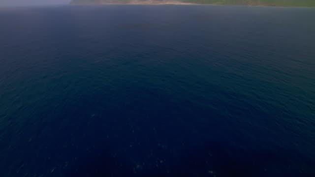Aerial of the Caribbean Sea and Montserrat Island.