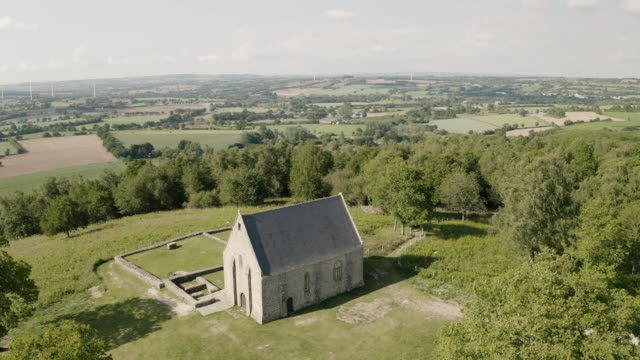 aerial of the chapelle de montaigu in mayenne, france. - france stock videos & royalty-free footage