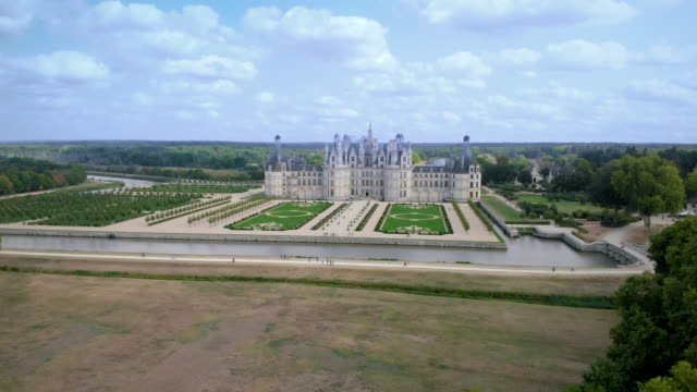 aerial of the chateau de chambord in france - wop productions stock-videos und b-roll-filmmaterial