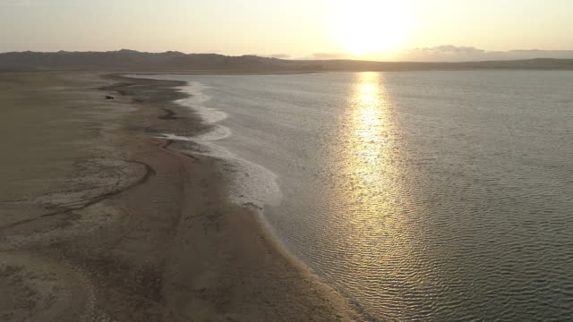 aerial of the coast and beach of paracas bay - kite sailing stock videos & royalty-free footage