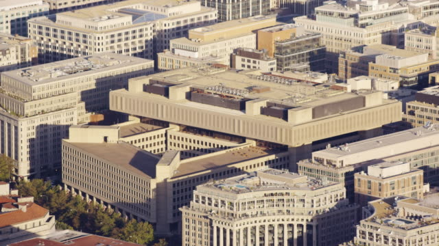aerial of the federal bureau of investigation headquarters, d.c. daytime - quartiere generale video stock e b–roll