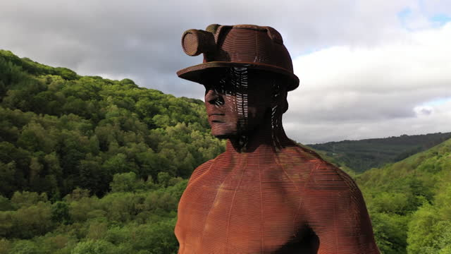 """aerial of the guardian monument in swansea valley, overlooking the six bells colliery site, now landscaped after a mining disaster in 1960, and used... - """"bbc news"""" stock videos & royalty-free footage"""