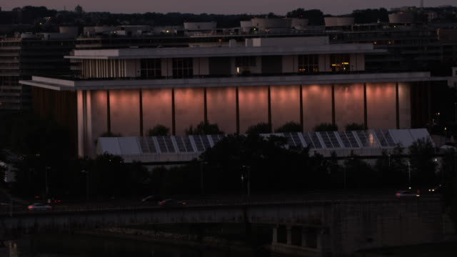 stockvideo's en b-roll-footage met aerial of the john f. kennedy center for the performing arts, evening dc - john f. kennedy