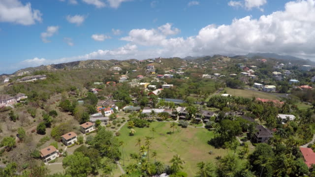 aerial of the landscape and surrounding houses / grenada, carribbean - caribbean stock videos and b-roll footage