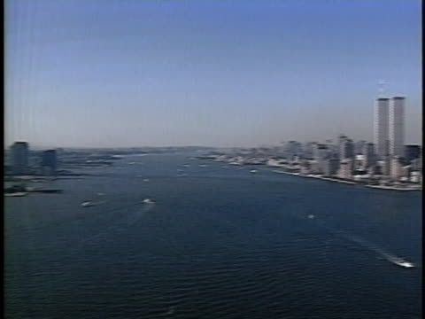aerial of the manhattan skyline with the world trade center's twin towers. - patriotism stock videos & royalty-free footage