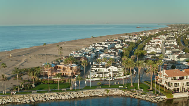 aerial of the newport channel in orange county - coastal feature stock videos & royalty-free footage