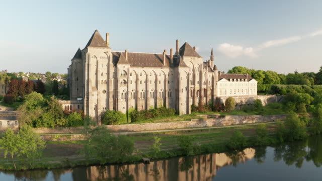 aerial of the river sarthe and the abbey at solesmes, sarthe, pays de la loire, france, europe - abbey stock videos & royalty-free footage