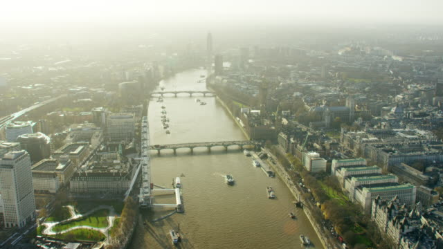 aerial of the river thames in london city - millennium wheel stock videos & royalty-free footage