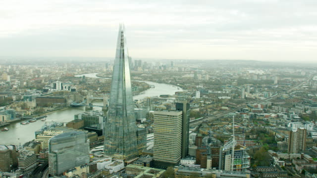 aerial of the shard tower and thames river - shard london bridge stock videos & royalty-free footage