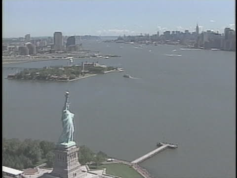 aerial of the statue of liberty. - patriotism stock videos & royalty-free footage
