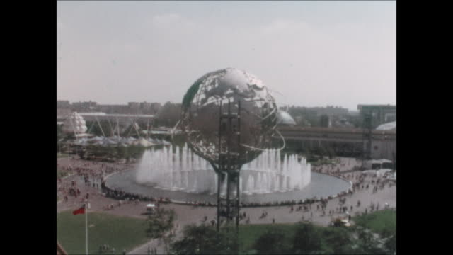 aerial of the unisphere during the 1964 world's fair in flushing meadows, queens. - unisphere stock videos & royalty-free footage