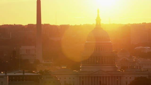 aerial of the united states capitol building, sunset, washington d.c. - washington monument washington dc stock videos & royalty-free footage