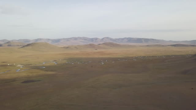 aerial of the vast landscapes of arkhangai province in mongolia. - mongolei stock-videos und b-roll-filmmaterial