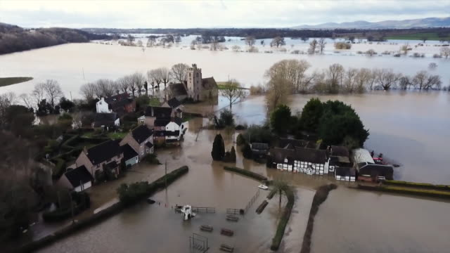 aerial of the village of severn stoke in worcestershire cut off by flood water - remote location stock videos & royalty-free footage