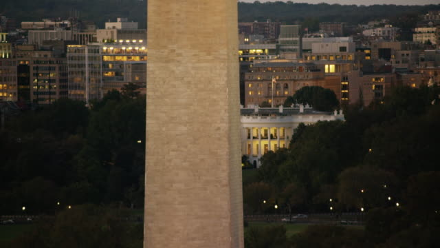 aerial of the washington monument and white house, evening washington dc - washington monument washington dc stock videos & royalty-free footage