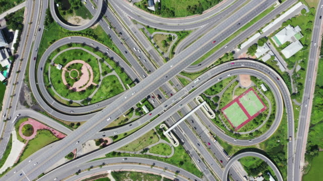 aerial of traffic loop on freeways - infinity stock videos & royalty-free footage