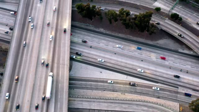aerial of traffic on freeways - traffic stock videos & royalty-free footage