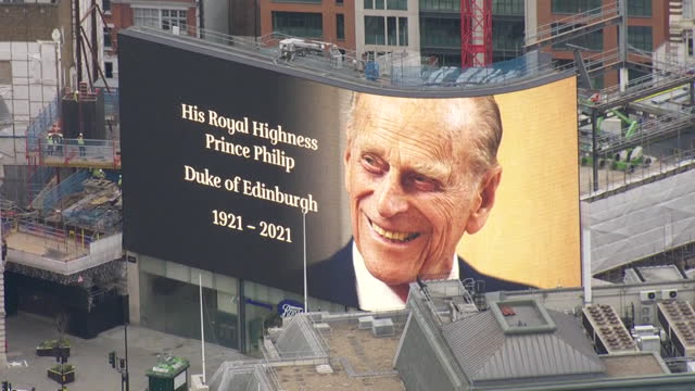 """aerial of tribute in piccadilly circus to prince philip, duke of edinburgh, following his death - """"bbc news"""" stock videos & royalty-free footage"""