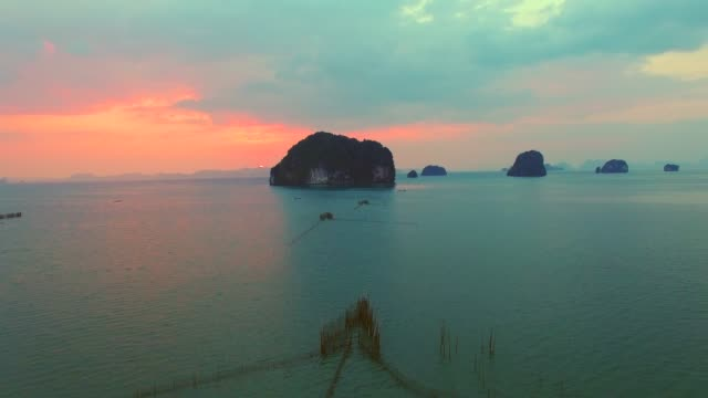 aerial of tropical sea cliffs at sunset - phi phi islands stock videos & royalty-free footage