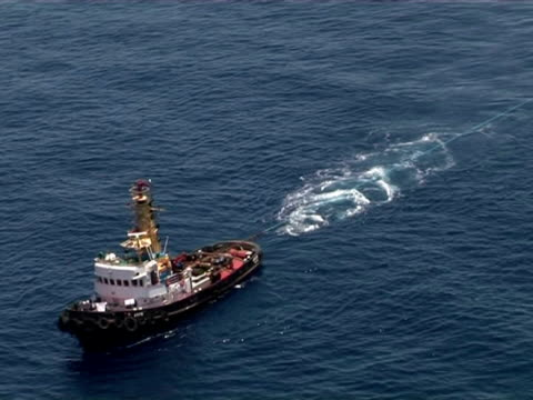 aerial of tug boat towing two cages with live blue fin tuna, mediterranean sea. - wide stock videos & royalty-free footage