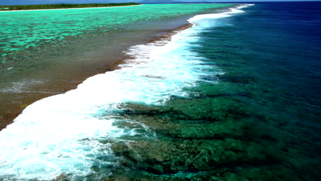 aerial of tupai heart island coral reef atoll - polinesia francese video stock e b–roll